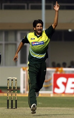 Sohail Tanvir celebrates after taking the wicket of Sachin