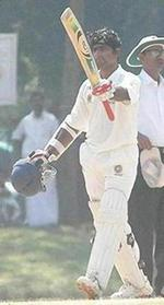 Sreekumar Nair raises his bat after crossing 300