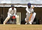Jasvir Singh plays a shot on the front foot during Services's first innings