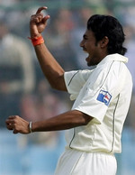 Danish Kaneria celebrates the wicket of Munaf Patel
