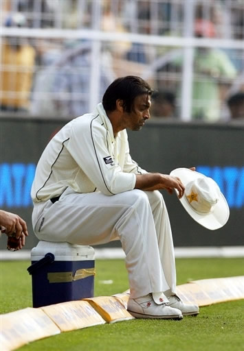 Shoaib Akhtar rests after a bowling spell