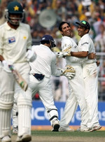 VVS Laxman celebrates the wicket of Mohammad Sami