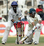 Younis Khan is bowled while playing a reverse sweep