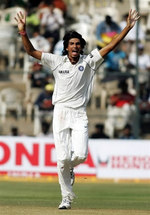Ishant Sharma celebrates the wicket of Faisal Iqbal