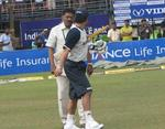 A Salim exchanges words with Sachin Tendulkar