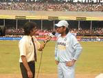 Indian captain MS Dhoni speaking to Rameez Raja after the toss