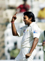 Danish Kaneria celebrates the wicket of Rahul Dravid