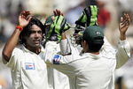 Mohammad Sami celebrates the wicket of Yuvraj Singh