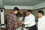 S Anish receives the award from SK Nair