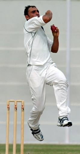 Samiullah Khan is about to deliver a ball
