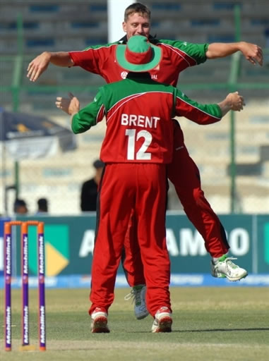 Ray Price celebrates the wicket of Mohammad Yousuf