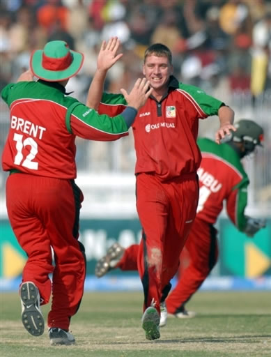Ray Price celebrates the wicket of Nasir Jamshed