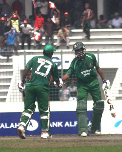 Shakib Al Hasan congratulates Raqibul Hasan after 50