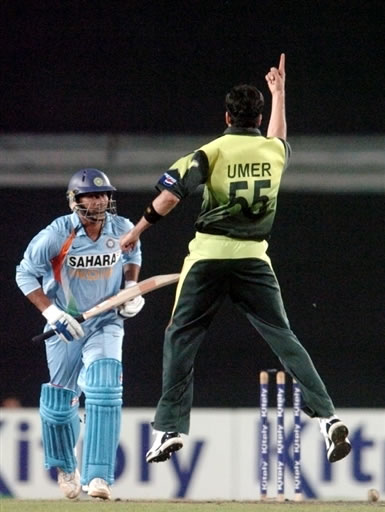 Umar Gul celebrates the wicket of Kumar