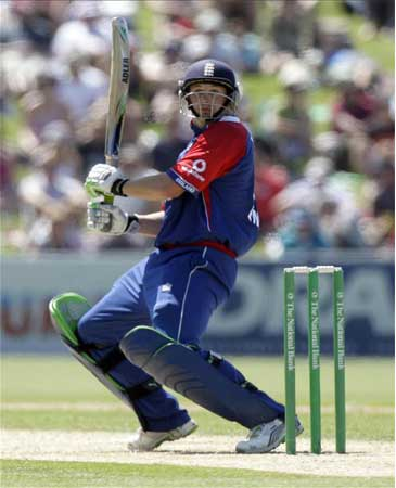England's Phil Mustard hits a shot to make 50 runs
