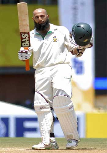 South Africa's Hashim Amla celebrates after completing his century