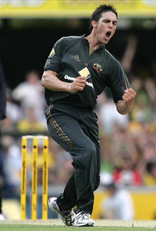 Mitchell Johnson celebrates getting the wicket of Gautam Gambhir