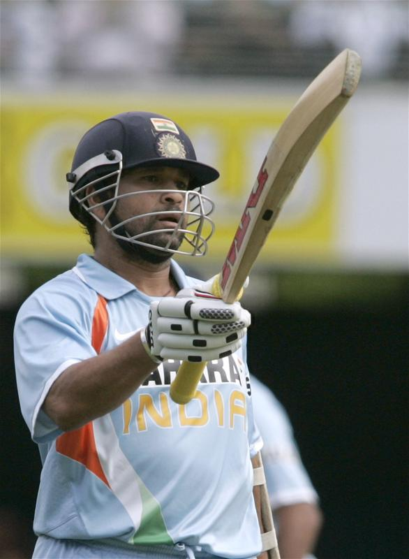 Sachin Tendulkar acknowledges the crowd after scoring his half century
