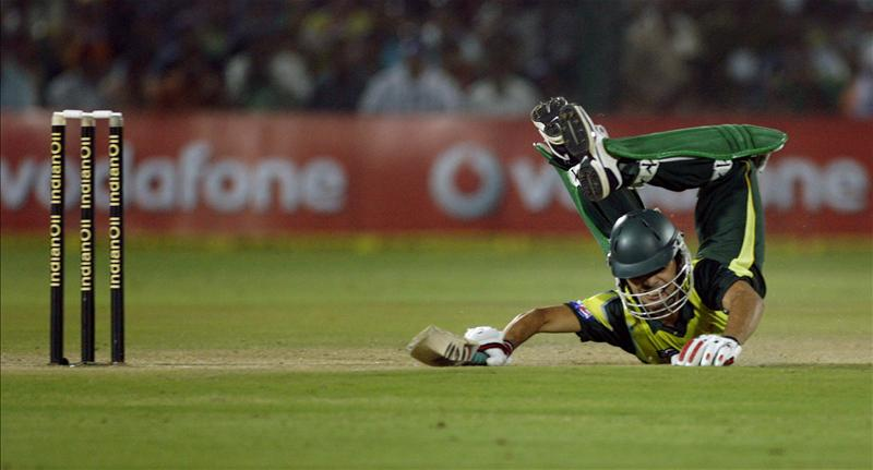 Fawad Alam dives to complete a run against India