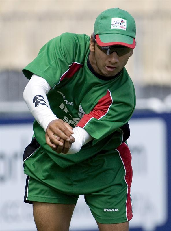 Tanmay Mishra catches the ball during a World Cup cricket training session