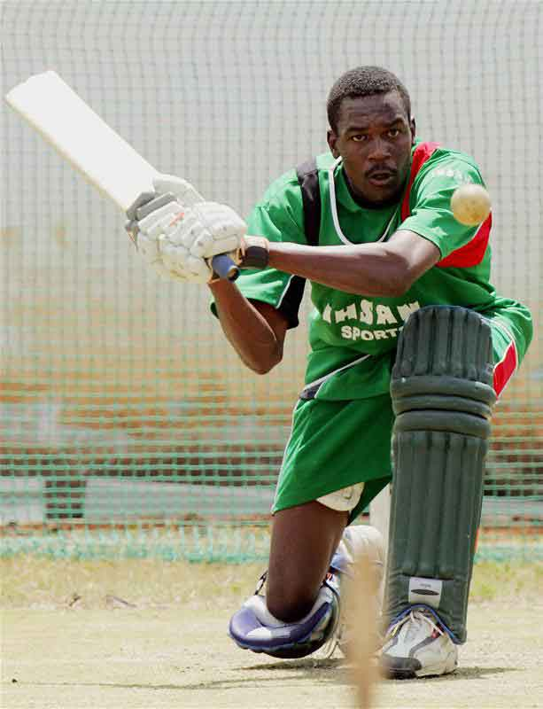 Collins Obuya hits a shot during a training session