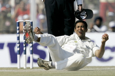 Anil Kumble celebrates after taking a diving catch