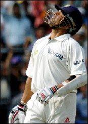 Sachin Tendulkar celebrates his 10,000 Test runs