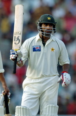 Yousuf Youhana raises his bat after scoring a century