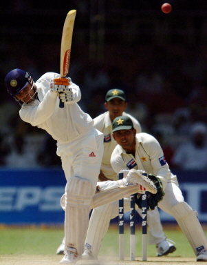 Virender Sehwag drives to midwicket on his way to 201