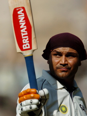 Virender Sehwag ackowledges the crowd after smashing 201