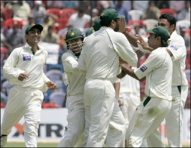 Pakistan team players celebrate a dismissal