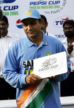 Virender Sehwag holds his 'Man of the Match' trophy