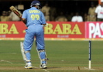 Sourav Ganguly looks back at his stumps after being bowled