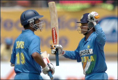 Virender Sehwag is watched by Rahul Dravid as he celebrates