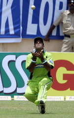 Naved-ul-Hasan takes a catch in the deep