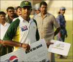 Naved-ul-Hasan with the Man of the Match awards