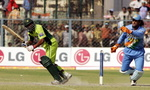 Yousuf Youhana clips a ball to leg past Mahender Dhoni