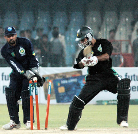 Mohammad Hafeez bowled as Moin Khan looks on