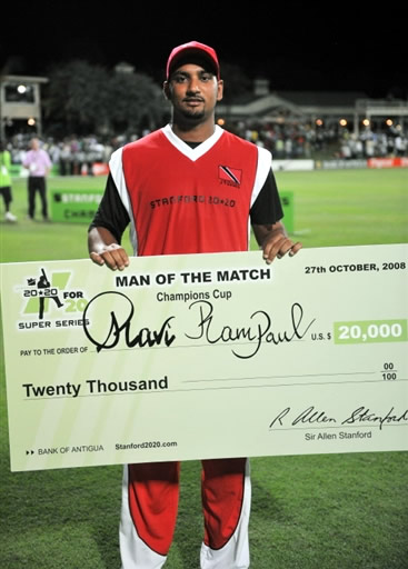 Ravi Rampaul poses with his Man of the Match cheque