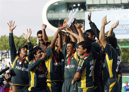 Pakistan players celebrate with the trophy