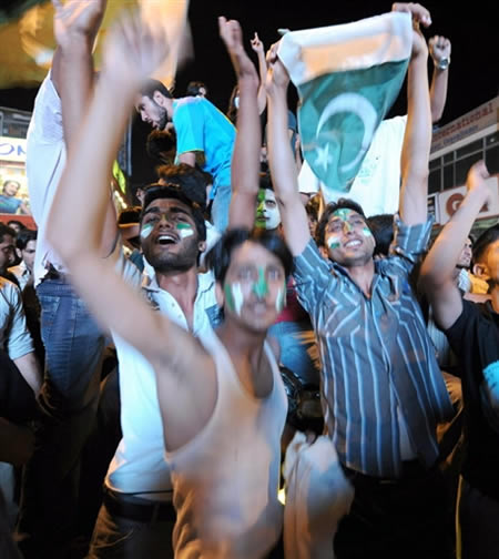 Pakistan fans celebrate in the streets of Islamabad