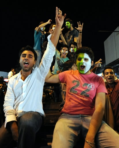 Pakistan fans celebrate in the streets of Lahore
