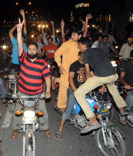 Pakistan fans celebrate in the streets of Karachi