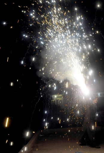 Pakistan fan lights fireworks in Karachi