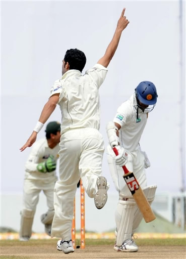 Umar Gul celebrates the wicket of Warnapura