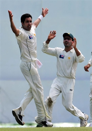 Umar Gul celebrates the wicket of Herath