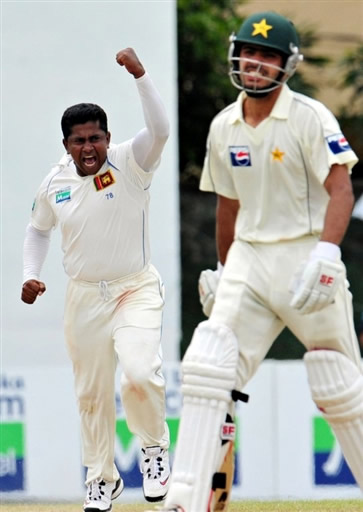 Herath celebrates the wicket of Fawad