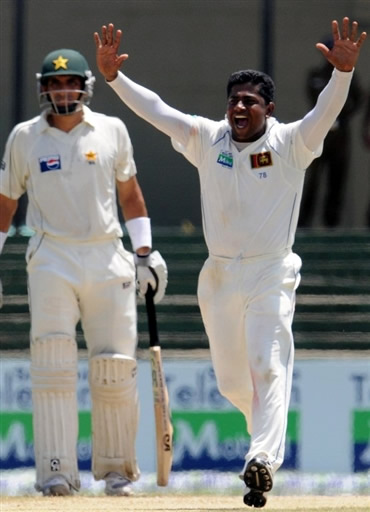 Herath celebrates the wicket of Yousuf