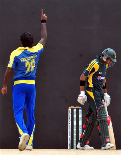 Fernando celebrates the wicket of Malik