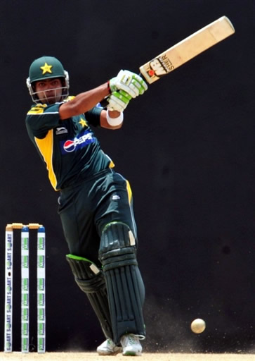 Umar Akmal plays a shot